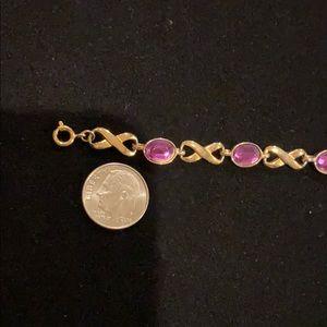 Avon Jewelry - Avon infinity purple bracelet